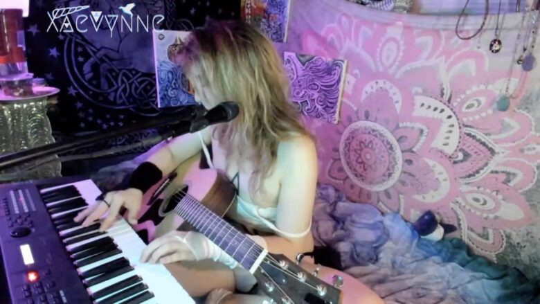 Xaevynne Serenades With Her Guitar
